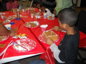 My son making a gingerbread house